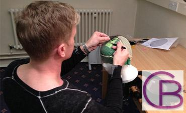 Chris Baguley crafting a hair system